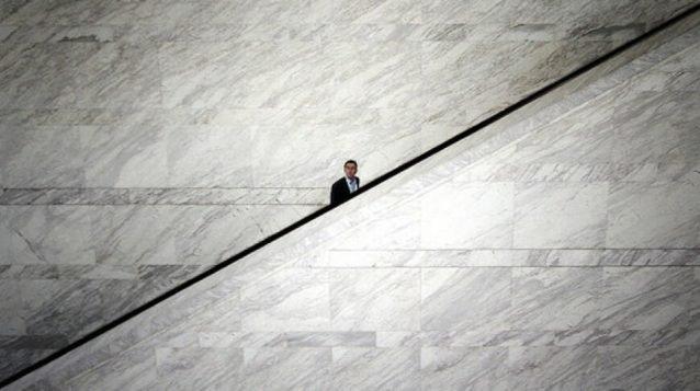 business man taking escalator