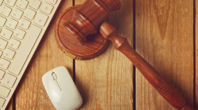 gavel with keyboard and mouse