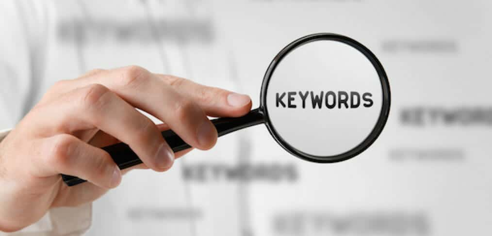 Find keywords concept. Marketing specialist looking for keywords (concept with magnifying glass). Keyword advertising concept.